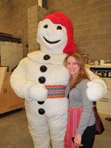Bonhomme Carnaval and one of his fans show off their arrow sashes.