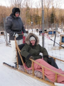 The rider gets a low-to-the-trail view; the musher gets an elevated view.