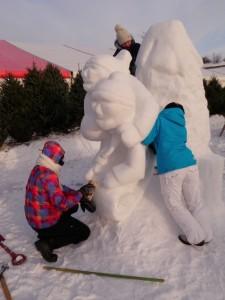 Three Michaelangelos finish a Carnaval sculpture.