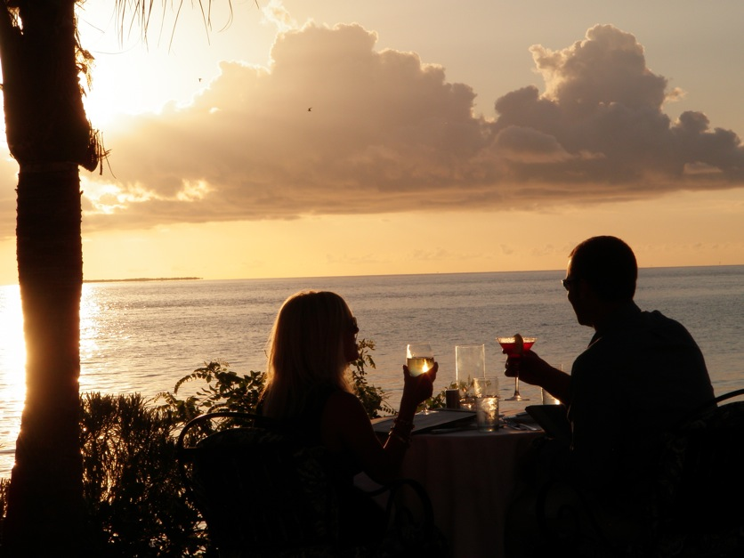 A Florida Keys trifecta: Someone special, an elegant meal and a beautiful sunset. (Photo by Tom Adkinson)