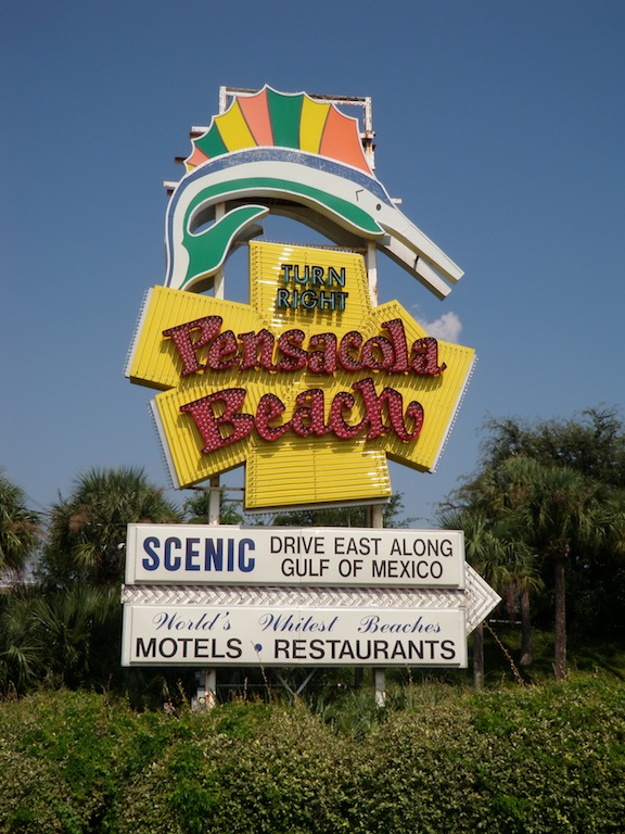 A neon sailfish points the way to Pensacola Beach. (Photo: Tom Adkinson)