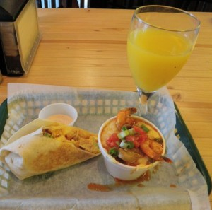 Crawfish andouille burrito, high-powered shrimp and grits and a mimosa. (Photo by Tom Adkinson)