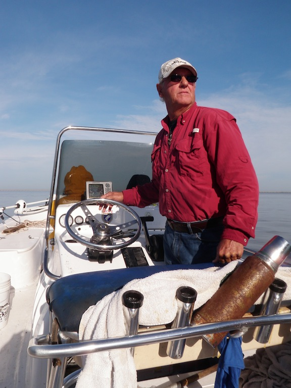 Captain Kenny Kreeger scans Lake Pontchartrain for just the right spot. (Photo: Tom Adkinson)