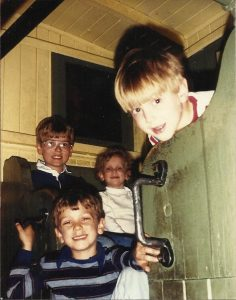 Gavin (in the glasses) with his siblings, in a caboose at the B&O Museum in Baltimore