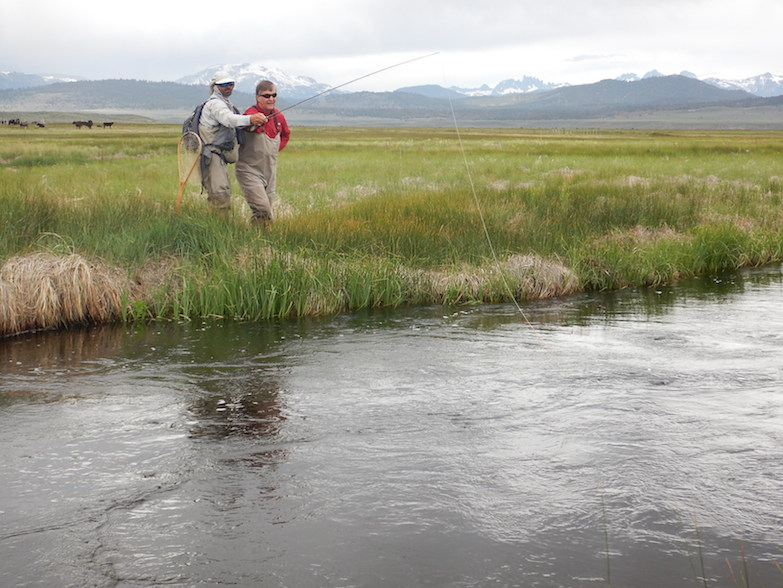 Trout guide Scott Flint coaches a fisherman on the upper Owens River. (Photo: Tom Adkinson)