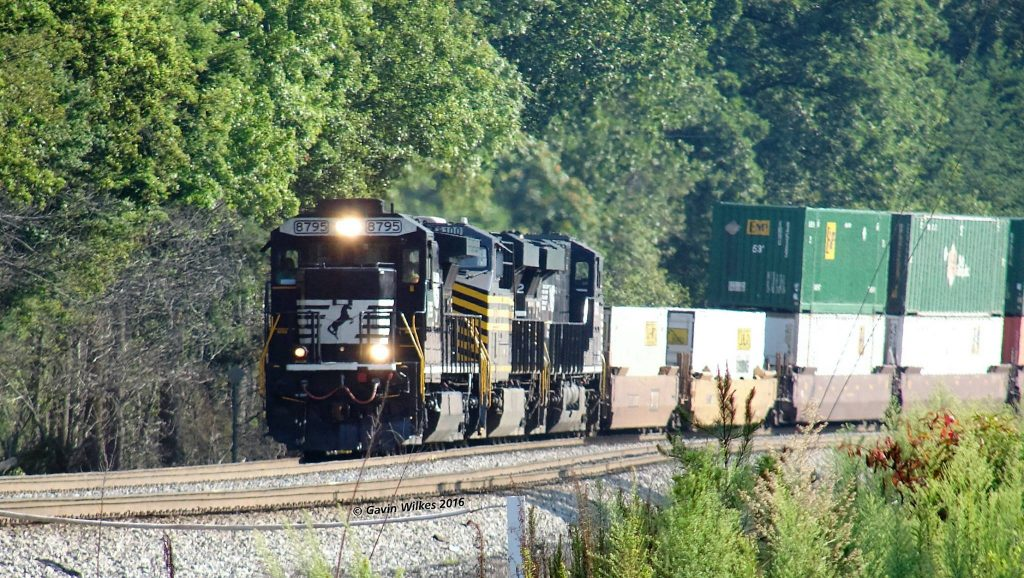 A southbound intermodal train approaches Control Point Swann with a special unit in the consist