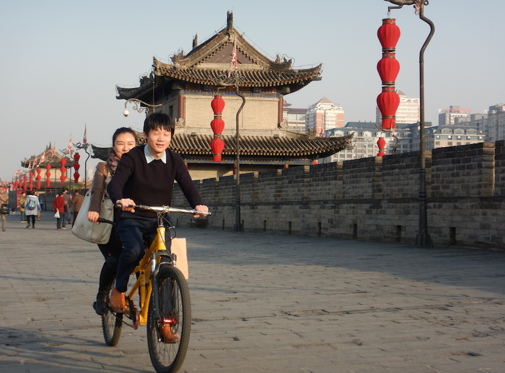 Bicyclists along the ancient city wall in Xian (Photo: Tom Adkinson)